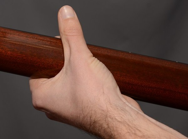 Bad thumb postion for bar chords. Thumb is too high.