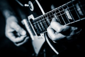 Close up of electric guitar player's hands