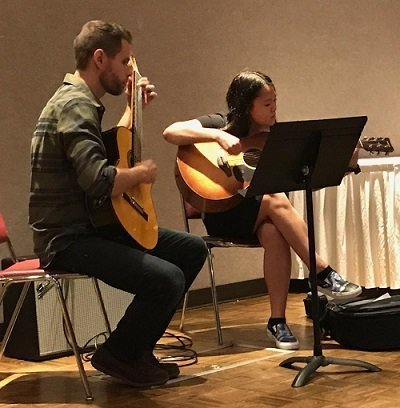 andy and a student at a guitar recital